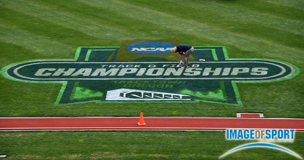 Jun 8, 2018; Eugene, OR, USA; Oregon Ducks director of track and field venues and program support Lance Deal paints the NCAA championships logo during the NCAA Track and Field championships at Hayward Field.