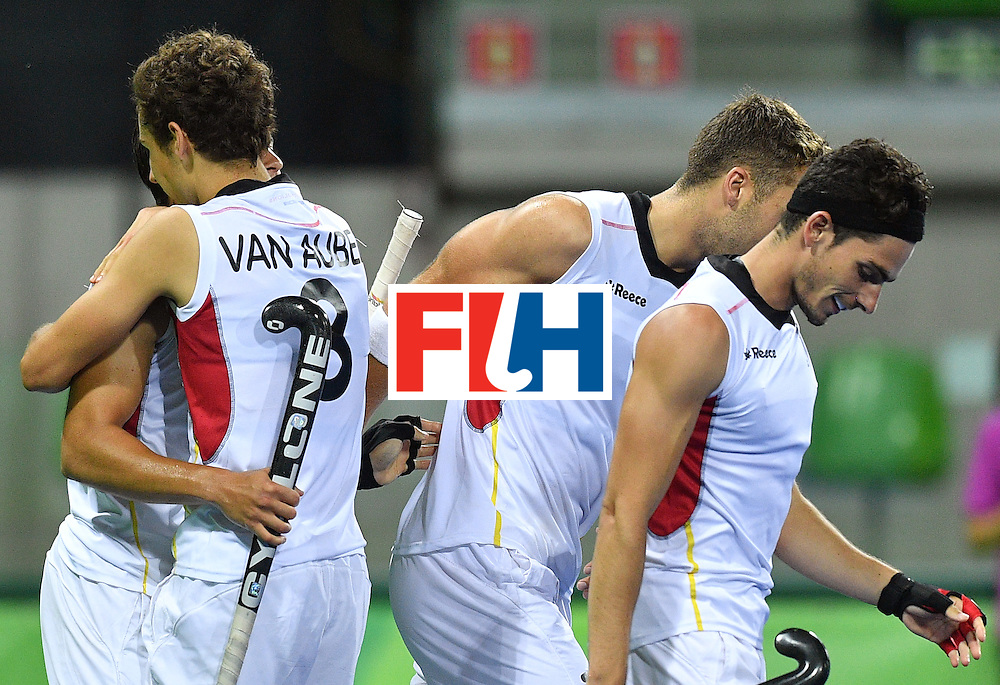 Belgium's Florent van Aubel (2nd L) celebrates a goal with teammates during the men's semifinal field hockey Belgium vs Netherlands match of the Rio 2016 Olympics Games at the Olympic Hockey Centre in Rio de Janeiro on August 16, 2016.  / AFP / Carl DE SOUZA        (Photo credit should read CARL DE SOUZA/AFP/Getty Images)