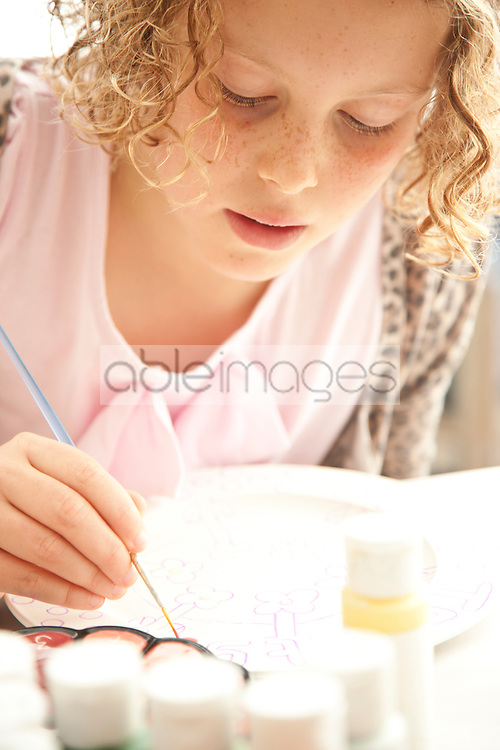 Girl Painting on Ceramic Plate