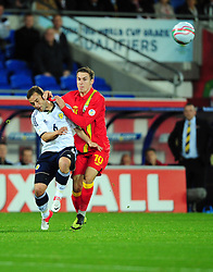 Wales Aaron Ramsey (Arsenal) battles for the ball with Scotland's Shaun Maloney (Wigan) - Photo mandatory by-line: Joe Meredith/JMP  - Tel: Mobile:07966 386802 12/10/2012 - Wales v Scotland - SPORT - FOOTBALL - World Cup Qualifier -  Cardiff   - Cardiff City Stadium -
