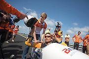Sebastiaan Bowier stapt in de VeloX3, de nieuwe fiets van het Human Powered Team Delft en Amsterdam,  voor de eerste rit op de  A31 tussen Franeker en Dronryp. Met de speciale ligfiets wil het team dat bestaat uit studenten van de TU Delft en de VU Amsterdam het wereldrecord fietsen verbreken. Dat staat nu op 133 km/h.<br /> <br /> At the A31 between Franeker and Donryp Sebastiaan Bowier rides the new bike of the Human Powered Team Delft and Amsterdam, the VeloX3. With the special recumbent bike the team, consisting of students of the TU Delft and the VU Amsterdam, wants to set a new world record cycling. The current speed record is 133 km/h.