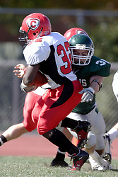 07 October 2006: Bo Osburn wraps up Chris Leathers. The Titans of Illinois Wesleyan University started off strong with a touchdown on the 2nd play from scrimmage in the game.  The Titans led most of the way, but failed to maintain the lead in the 4th quarter giving up the decision of this CCIW conference game to the Red Men of Carthage by a score of 31 - 28. Action was at Wilder Field on the campus of Illinois Wesleyan University in Bloomington Illinois.<br />