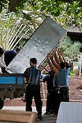 Ao Phrao Resort. Unloading a refrigerator.