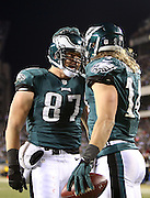 Philadelphia Eagles wide receiver Riley Cooper (14) celebrates with Philadelphia Eagles tight end Brent Celek (87) after Riley catches a 10 yard touchdown pass good for a 7-3 second quarter Eagles lead during the NFL NFC Wild Card football game against the New Orleans Saints on Saturday, Jan. 4, 2014 in Philadelphia. The Saints won the game 26-24. ©Paul Anthony Spinelli