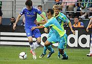 July 18, 2012: CenturyLink Field, Seattle, WA: Chelsea FC midfielder Lucas Piazon battles Sounders Patrick Ianni at the World Football Challenge. Chelsea FC defeated the Seattle Sounders 4-2.