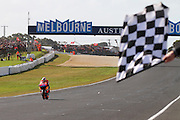 World Moto GP Championship. Checkered flag - End of race - STONER - <br /> Round16.Phillip Island.Australia.Sunday16.10.2011.<br /> #27 Casey STONER (AUS) Repsol Honda Team.<br /> Wins the race and is crowned the 2011 Moto GP Champion on his 26th birthday.<br /> © ATP Photo/ Damir IVKA<br /> Motorrad-WM - MotoGP in Australien - Motorrad - Moto GP -Motorradsport - Grand Prix in Phillip Island - Motorcycle racing in Australia - Moto2 - 16.10.2011 - <br /> - fee liable image - Photo Credit: © ATP / Damir IVKA
