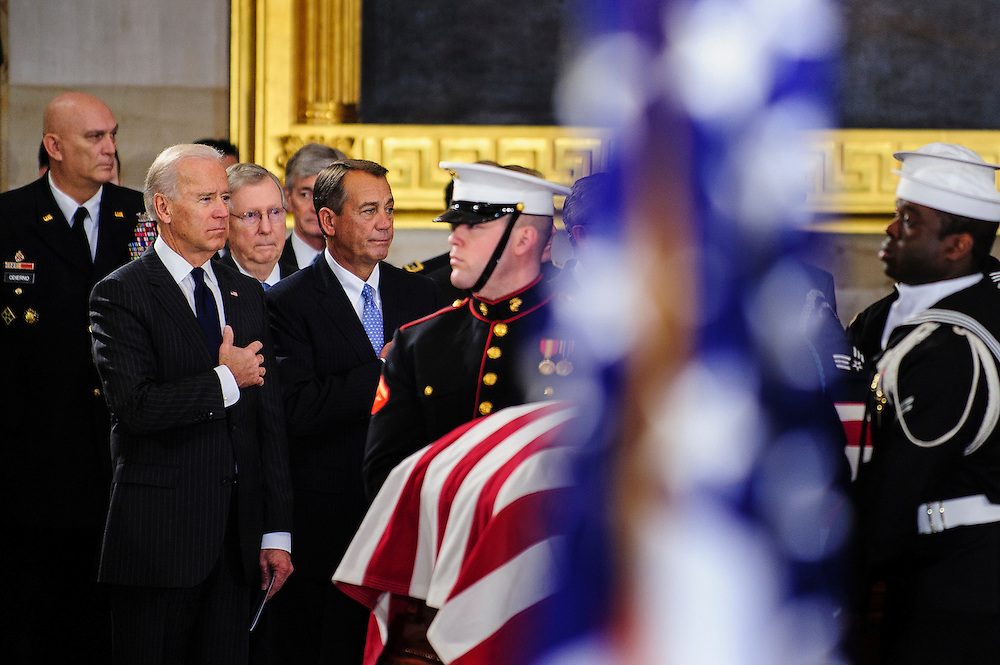 Vice President JOE BIDEN and Speaker of the House JOHN BOEHNER (R-OH) look on as a military honor guard carries the casket of the late Senator Daniel Inouye (D-HI) into the U.S. Capitol Rotunda before a service and public viewing on Thursday. Inouye passed away at the age of 88 on December 18 at the Walter Reed National Military Medical Center in Bethesda, Md. Inouye, 88, a decorated World War II veteran and the second-longest serving senator in history will lie in state until Friday when a memorial service will be held at the National Cathedral.