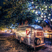 A number of these wonderful American-style food vans adorn the Thames' South Bank promenade and at night they reflect the tree lights in their metal frames.