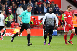 An assistant referee runs away from Junior Morias of Peterborough United at full-time after disallowing his goal - Mandatory by-line: Joe Dent/JMP - 16/09/2017 - FOOTBALL - Banks's Stadium - Walsall, England - Walsall v Peterborough United - Sky Bet League One