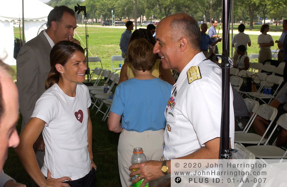 "Mia Hamm, star of Team USA's female soccer squad chats with Surgeon General Richard Carmona at the ""Kids in Action,"" event on Monday July 21, 2003."