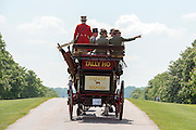 © Licensed to London News Pictures. 16/05/2014. Windsor, UK. People drive their carriages along the Long Walk against a back drop of Windsor Castle today 16th May 2014.  The third day of The Royal Windsor Horse Show, set in the grounds of Windsor Castle. Established in 1943. Photo credit : Stephen Simpson/LNP