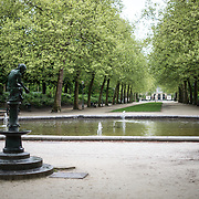 A statue of a girl and a fountain in Brussels Park across from the Royal Palace of Brussels in central Brussels, Belgium.