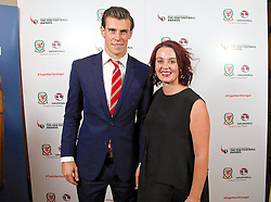 CARDIFF, WALES - Monday, October 6, 2014: Wales' Gareth Bale and BBC reporter Juliette Ferrington at the FAW Footballer of the Year Awards 2014 held at the St. David's Hotel. (Pic by David Rawcliffe/Propaganda)
