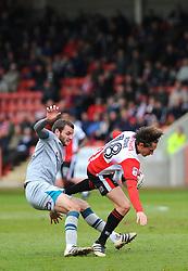 James Rowe of Cheltenham Town is fouled by Jamey Osborne of Grimsby Town -Mandatory by-line: Nizaam Jones/JMP - 17/04/2017 - FOOTBALL - LCI Rail Stadium - Cheltenham, England - Cheltenham Town v Grimsby Town - Sky Bet League Two