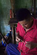 Catato LÛpez, Bribri man working on handmade necklace. A day with the Bribri, indigenous people in LimÛn Province of Costa Rica