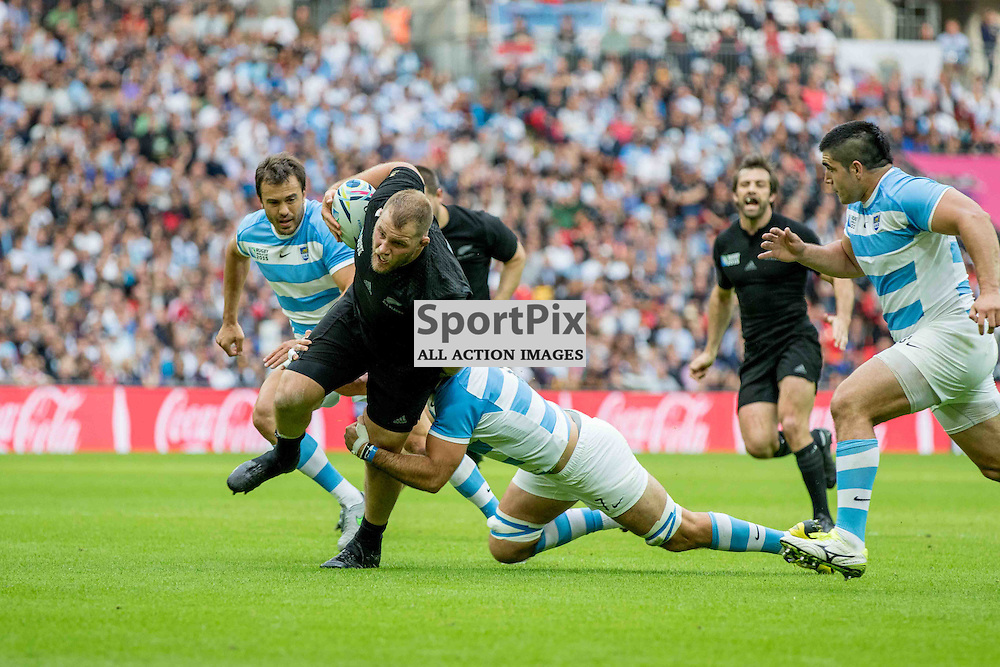 Ben Franks of New Zealand is tackled during the Rugby World Cup New Zealand v Argentina, Sunday 20 September 2015, Wembley Stadium (Photo by Mike Poole)