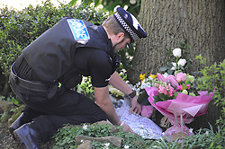 © Licensed to London News Pictures. 09/04/2014<br /> Peaches Geldof Death.<br /> Police outside the home of Peaches Geldof this morning (09.04.2014) as flowers start to arrive from local residents.<br /> Photo credit :Grant Falvey/LNP