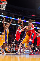 22 March 2013: Guard (2) John Wall of the Washington Wizards passes the ball against the Los Angeles Lakers during the second half of the Wizards 103-100 victory over the Lakers at the STAPLES Center in Los Angeles, CA.