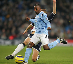 MANCHESTER, ENGLAND - WEDNESDAY, JANUARY 4th, 2006: Manchester City's Darius Vassell tackled by Tottenham Hotspur's Michael Dawson during the Premiership match at the City of Manchester Stadium. (Pic by David Rawcliffe/Propaganda)