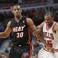 14 March 2012: Miami Heat point guard Norris Cole (30) drives past Chicago Bulls point guard John Lucas III (15) during the Chicago Bulls 106-102 victory over the Miami Heat at the United Center, Chicago, Illinois, USA.