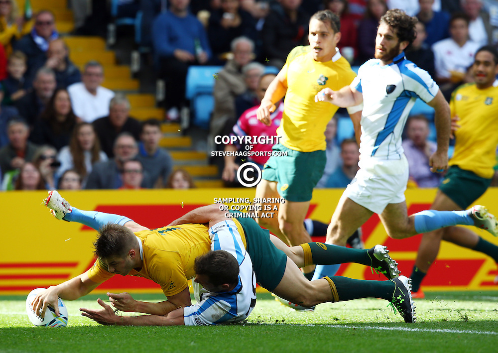 BIRMINGHAM, ENGLAND - SEPTEMBER 27: Drew Mitchell of Australia over for a try during the Rugby World Cup 2015 Pool A match between Australia and Uruguay at Villa Park on September 27, 2015 in Birmingham, England. (Photo by Steve Haag/Gallo Images)