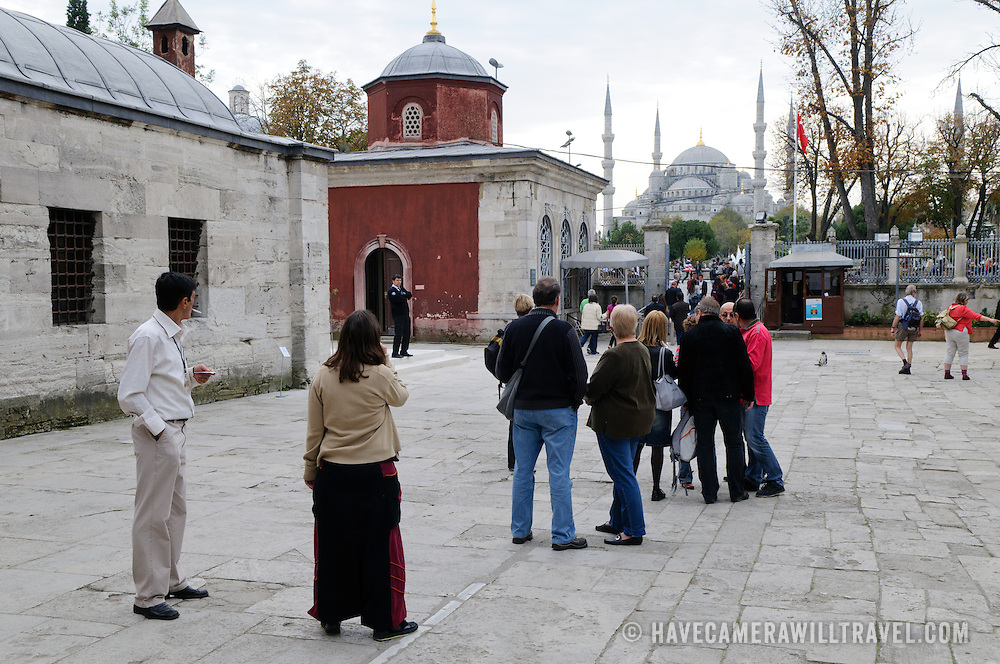 Tourists in the courtyard of Hagia Sophia looking towards the Blue Mosque fin the distance in the Sultanahment district of Istanbul.
