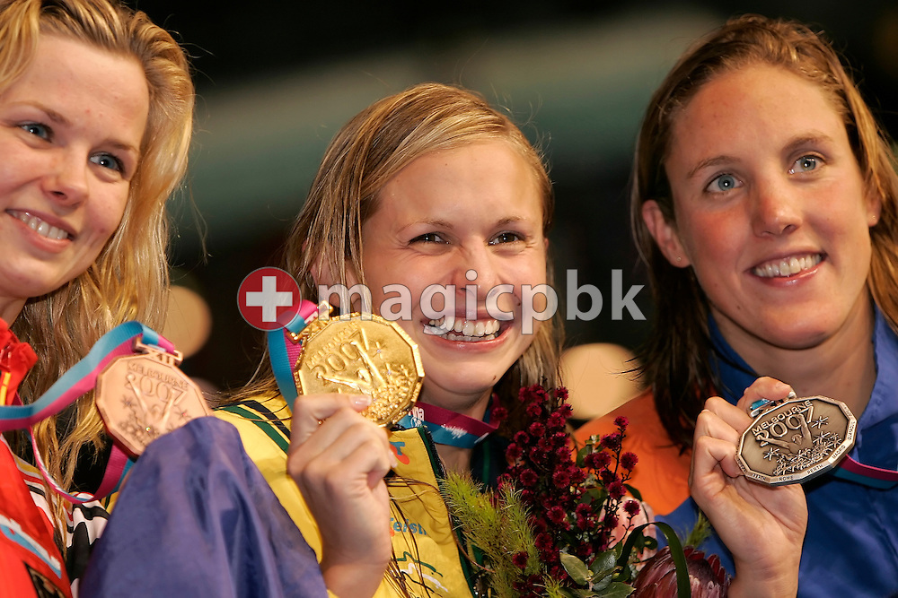 Lisbeth Lenton of Australia (C) poses with her gold medal, Marleen Veldhuis of the Netherlands (R) poses with her silver medal and Britta Steffen (L) of Germany poses with her bronze medal the award ceremony of the  women's 100m freestyle final in the Susie O'Neill pool at the FINA Swimming World Championships in Melbourne, Australia, Friday 30 March 2007. (Photo by Patrick B. Kraemer / MAGICPBK)