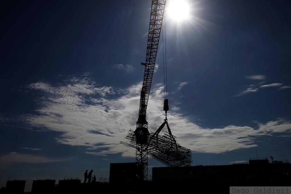 A crane moves metal structures at a hotel construction site  Brasilia, Brazil, Thursday, Feb. 9, 2012.(Photo Dado Galdieri)