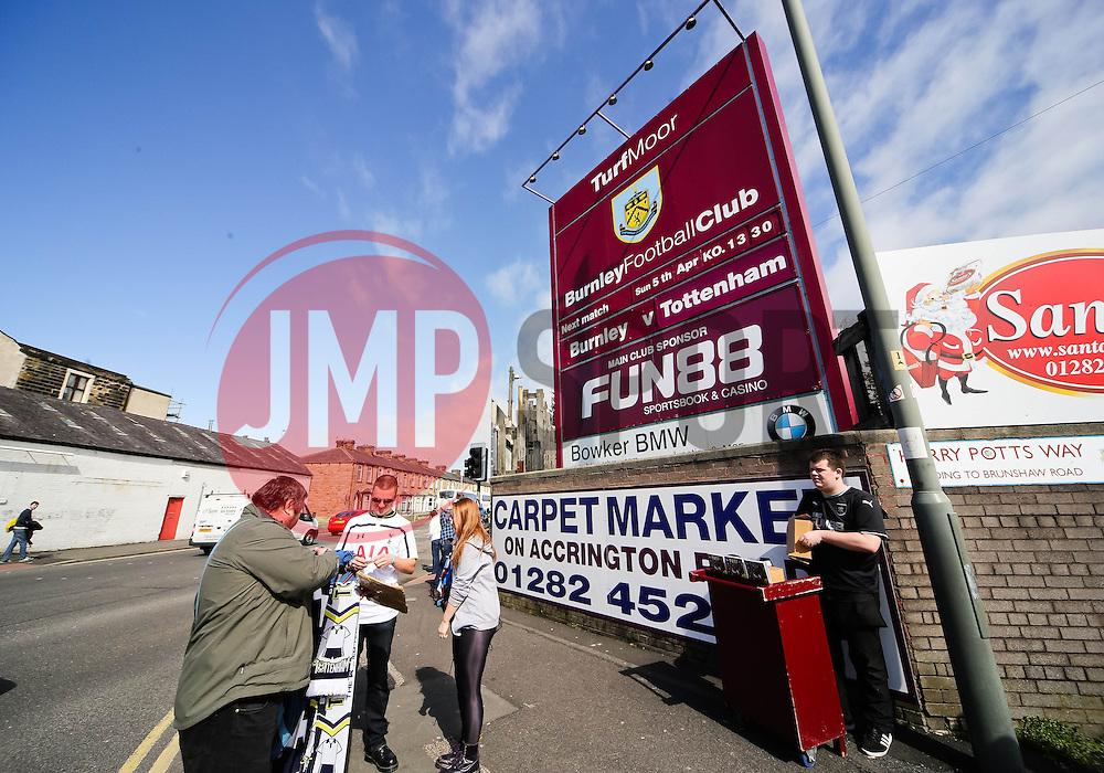 Tottenham fans purchase some merchandise outside Turf Moor - Photo mandatory by-line: Matt McNulty/JMP - Mobile: 07966 386802 - 05/04/2015 - SPORT - Football - Burnley - Turf Moor - Burnley v Tottenham Hotspur - Barclays Premier League