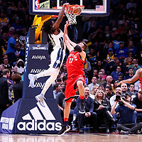 01 November 2017: Denver Nuggets forward Kenneth Faried (35) dunks the ball over Toronto Raptors center Jonas Valanciunas (17) during the Denver Nuggets 129-111 victory over the Toronto Raptors, at the Pepsi Center, Denver, Colorado, USA.