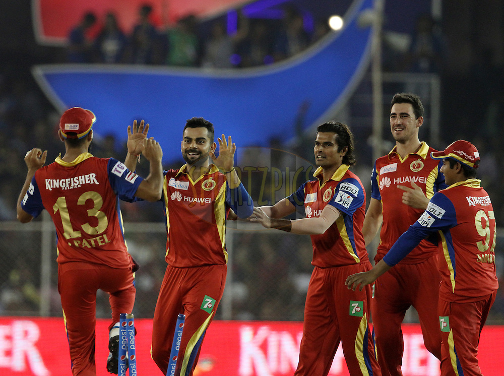 Royal Challengers Bangalore players celebrates the wicket Rajasthan Royals player Karun Nair during match 22 of the Pepsi IPL 2015 (Indian Premier League) between The Rajasthan Royals and The Royal Challengers Bangalore held at the Sardar Patel Stadium in Ahmedabad , India on the 24th April 2015.<br /> <br /> Photo by:  Vipin Pawar / SPORTZPICS / IPL