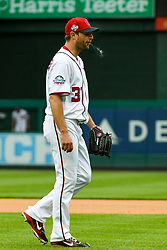 May 6, 2018 - Washington, DC, U.S. - WASHINGTON, DC - MAY 06:  Washington Nationals starting pitcher Max Scherzer (31) spits as he exits the field after being taken out of the game in the sixth inning during the game between the Philadelphia Phillies and the Washington Nationals on May 6, 2018, at Nationals Park, in Washington D.C.  The Washington Nationals defeated the Philadelphia Phillies, 5-4.  (Photo by Mark Goldman/Icon Sportswire) (Credit Image: © Mark Goldman/Icon SMI via ZUMA Press)