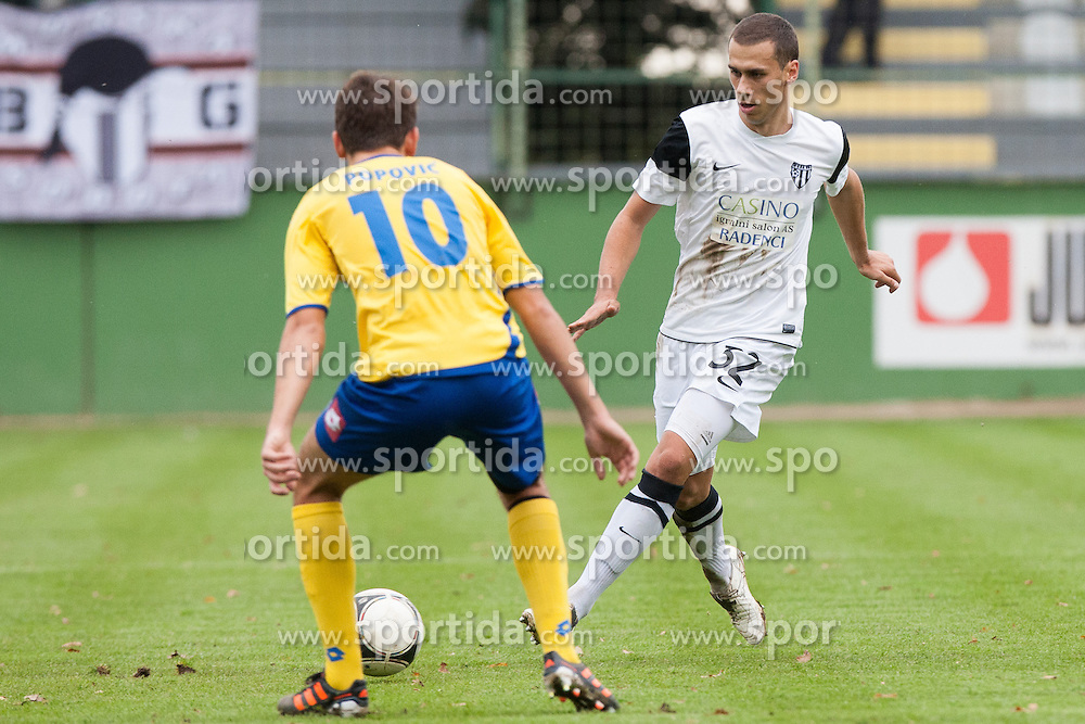 Denis Popovic #10 of FC Luka Koper and Mate Eterovic #32 of NK Mura 05 during football match between NK Mura 05 and NK Luka Koper in 16th Round of Slovenian First League PrvaLiga NZS 2012/31 on November 4, 2012 in Stadium Fazanerija, Murska Sobota, Slovenia. (Photo By Gregor Krajncic / Sportida)