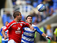 Stephen Foster (6) of Barnsley (L) challenges Shane Long (9) of Reading during the Npower Championship match between Reading and Barnsley on Saturday 25th September 2010 at the Madejski Stadium, Reading, UK. (Photo by Andrew Tobin/Focus Images)