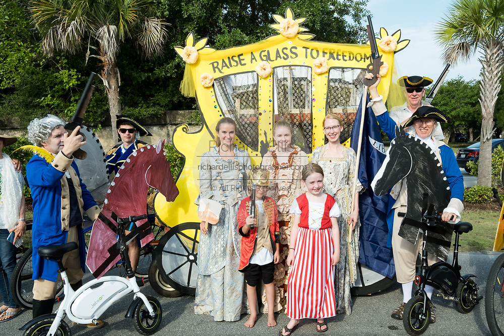 The winners of the annual Independence Day golf cart and bicycle parade pose in front of their Alexander Hamilton themed golf cart in costume July 4, 2019 in Sullivan's Island, South Carolina. The tiny affluent Sea Island beach community across from Charleston holds an outsized golf cart parade featuring more than 75 decorated carts.