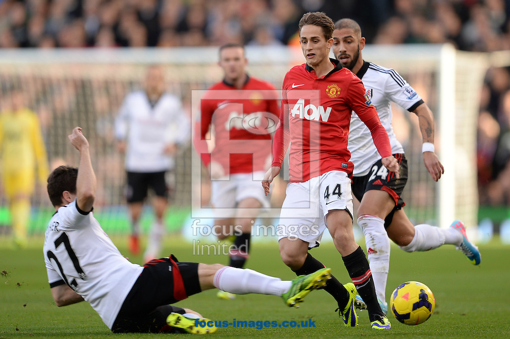 Picture by Andrew Timms/Focus Images Ltd +44 7917 236526<br /> 02/11/2013<br /> Sascha Riether of Fulham and Adnan Januzaj of Manchester United during the Barclays Premier League match at Craven Cottage, London.