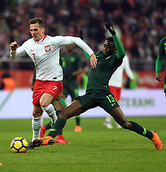 WROCLAW, March 24, 2018  Arkadiusz Milik (L) of Poland vies with Wilfred Ndidi of Nigeria during an international friendly game between Poland and Nigeria in Wroclaw, Poland, on March 23, 2018. Nigeria won 1-0. (Credit Image: © Jaap Arriens/Xinhua via ZUMA Wire)