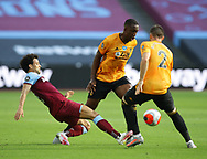Felipe Anderson of West Ham United challenges Willy Boly of Wolverhampton Wanderers during the Premier League match at the London Stadium, London. Picture date: 20th June 2020. Picture credit should read: David Klein/Sportimage