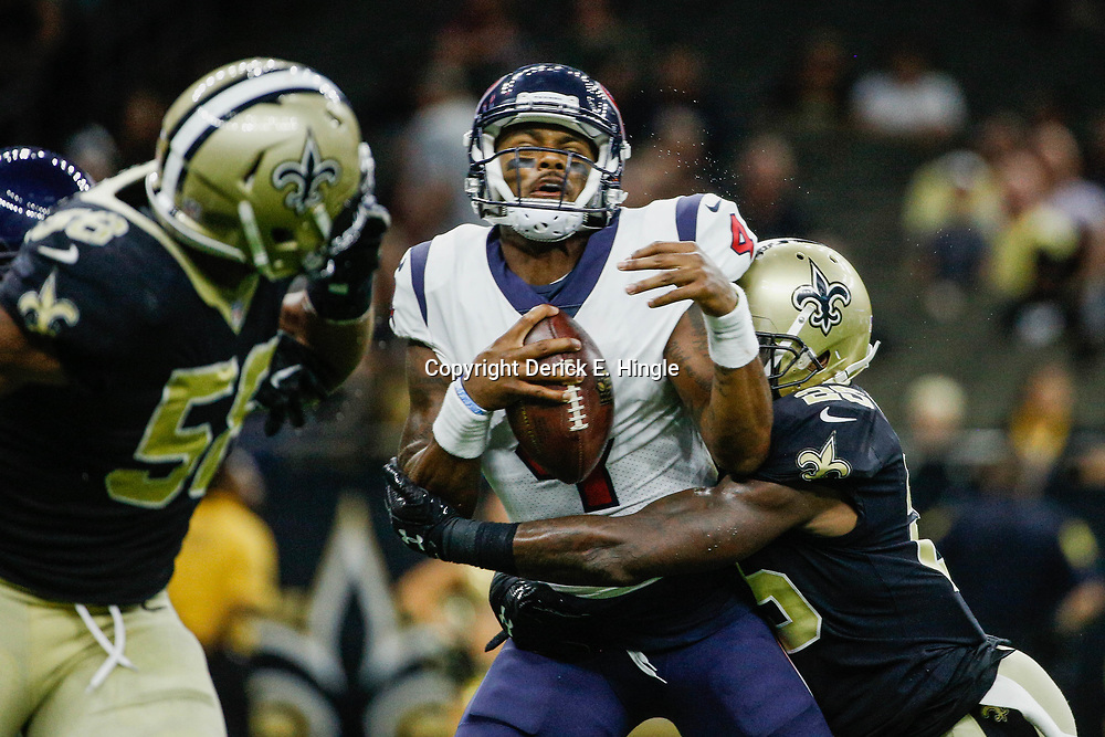 Aug 26, 2017; New Orleans, LA, USA; New Orleans Saints safety Rafael Bush (25) sacks Houston Texans quarterback Deshaun Watson (4) during the second half of a preseason game at the Mercedes-Benz Superdome. The Saints defeated the Texans 13-0. Mandatory Credit: Derick E. Hingle-USA TODAY Sports