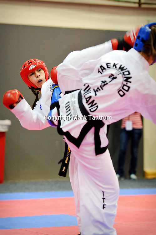Carolina Dillen competing in the womens sparing event at the International Taekwon-Do World Championships 2011. TSB Arena, Wellington, New Zealand.<br /> <br /> Photo: Mark Tantrum/photosport.co.nz
