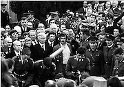 Funeral of Eamon DeValera.   (J72)..1975..02.09.1975..09.02.1975..2nd September 1975..Today saw the funeral of Eamon DeValera. He was laid to rest beside his wife Sinead in Glasnevin Cemetery,Dublin. Dignitries from all around the world attended at the funeral...Picture of the honour guard lowering the coffinto the grave.
