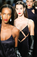 A model walks the runway wearing Cushnie et Ochs Fall 2016, hair by Antonio Corral Calero for Moroccanoil, makeup by Val Garland, photographed by Thomas Concordia during New York Fashion Week on February 12, 2016