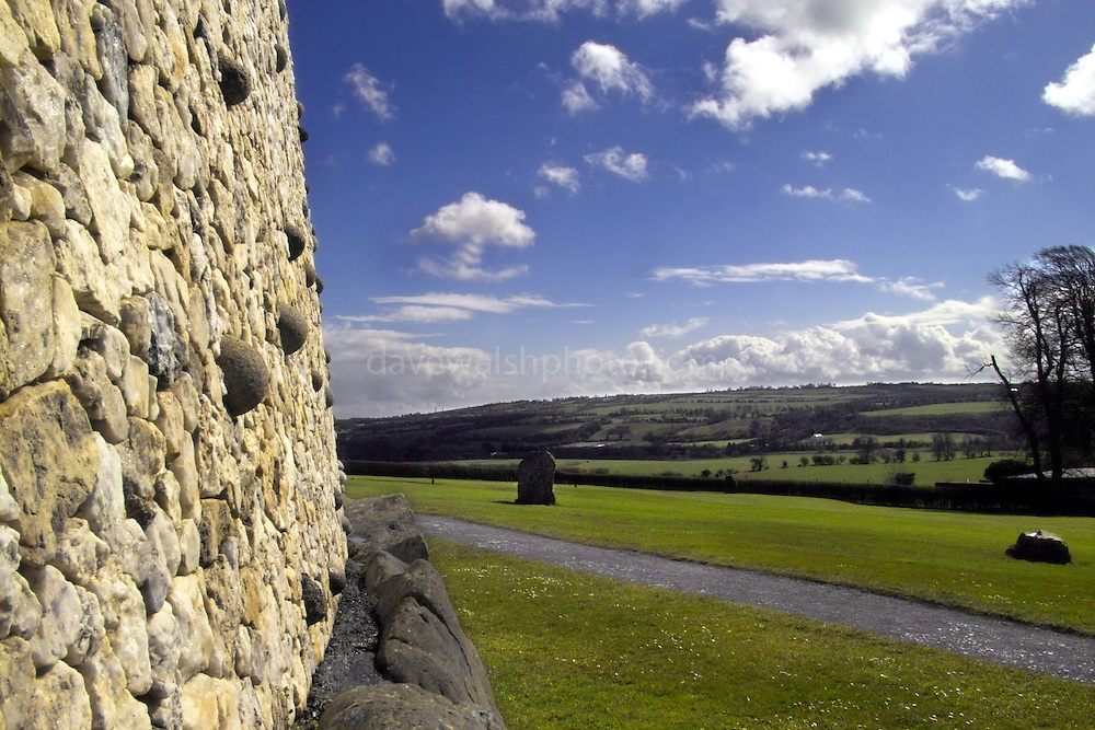 This quartz and granite face is a modern reconstruction - using the original materials - of how Newgrange must have looked 5,000 years ago. The quartz came from about 60km south, while the granite rocks came from farther north. The stones on the bottom weigh between 1 and 10 tonnes - and were put here 5,000 years ago!....