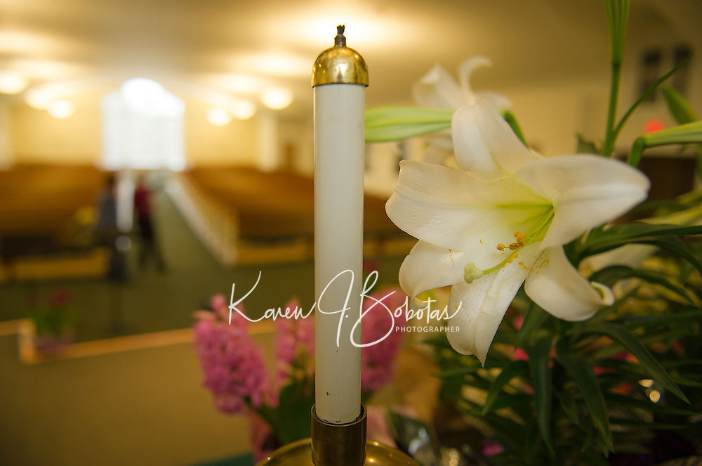 """Gilford Community Church gets decorated with Lilies and Hyacynths on Friday morning for Easter Sunday services by the """"flower committe"""" Penny Franciosi, Judy Robertson, Jane Rollins and Sandra Stafford.   (Karen Bobotas/for the Laconia Daily Sun)"""