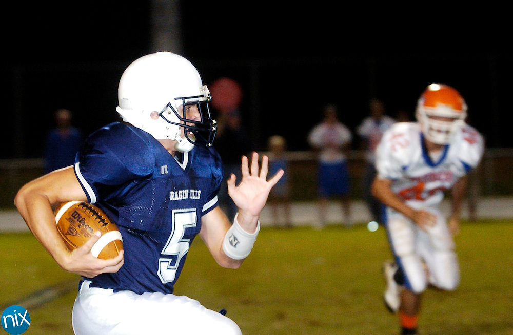 Hickory Ridge's Brett Lilly carries the ball against Marvin Ridge Friday, October 10, 2008. (Photo by James Nix)