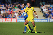 AFC Wimbledon defender George Francomb (7) battles for possession with Bristol Rovers striker Byron Moore (22) during the EFL Sky Bet League 1 match between AFC Wimbledon and Bristol Rovers at the Cherry Red Records Stadium, Kingston, England on 8 April 2017. Photo by Matthew Redman.