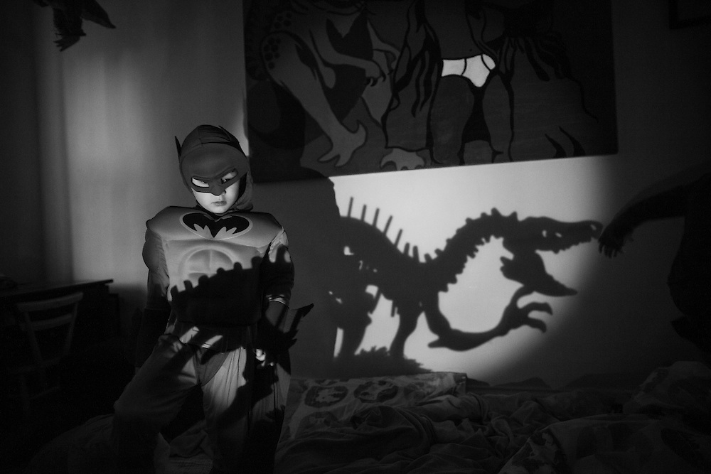 Ben dressed in a batman costume plays shadow puppets in his bedroom during  a sleep over with his cousin at home in Berkhamsted, England Sunday, Feb. 8, 2015 (Elizabeth Dalziel) #thesecretlifeofmothers #bringinguptheboys #dailylife