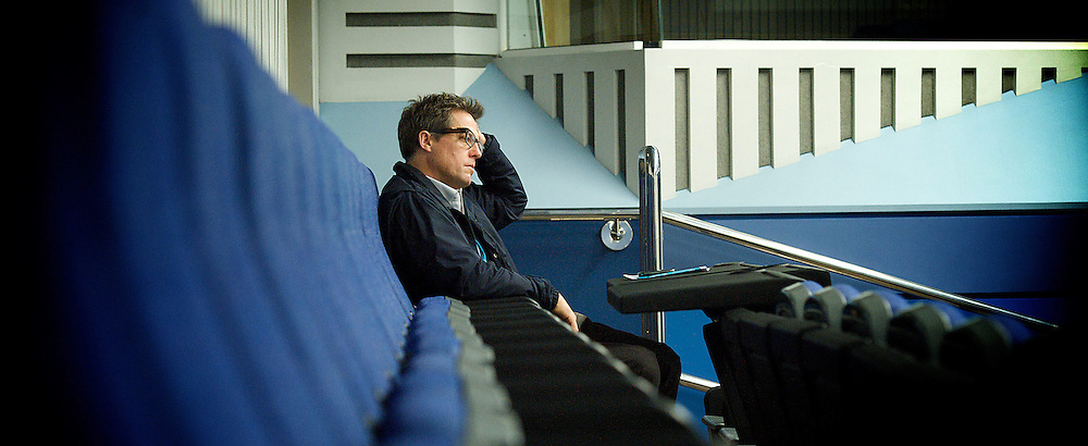 Hugh Grant sitting alone at the back of the room listening to Charlotte Church speaking at the Hacked Off fringe meeting during the Conservative Party Conference, ICC, Birmingham, Great Britain, October 10, 2012. Photo by Elliott Franks / i-Images.