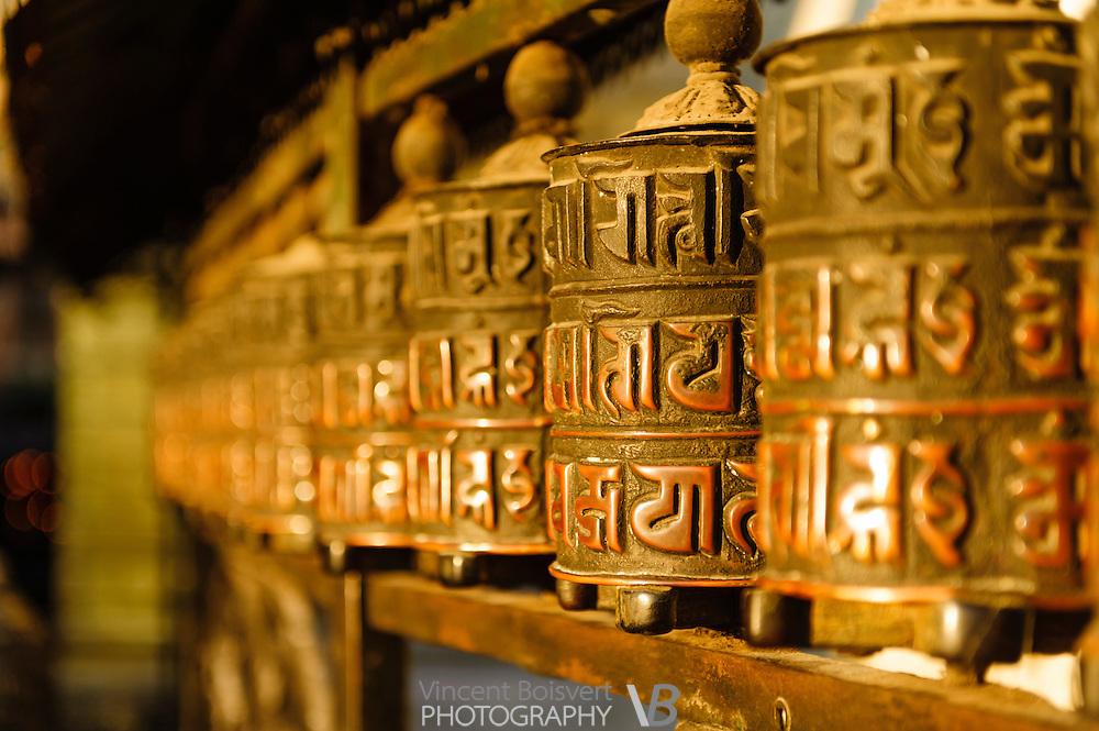 a close-up view of a Tibetan prayer wheel at the monkey temple of kathmandu, nepal