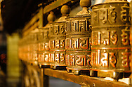 a close-up view of a Tibetan prayer wheel at the monkey temple of kathmandu, nepal